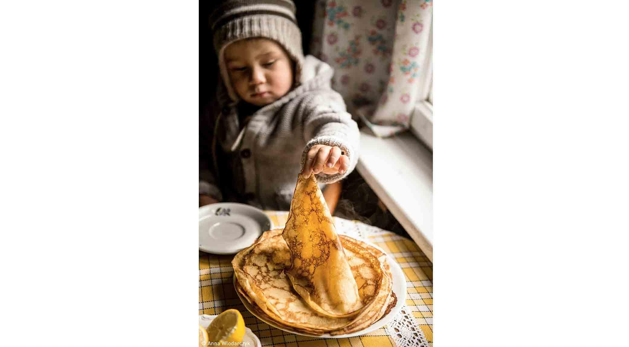 Olek Eating Pancakes by Anna Włodarczyk