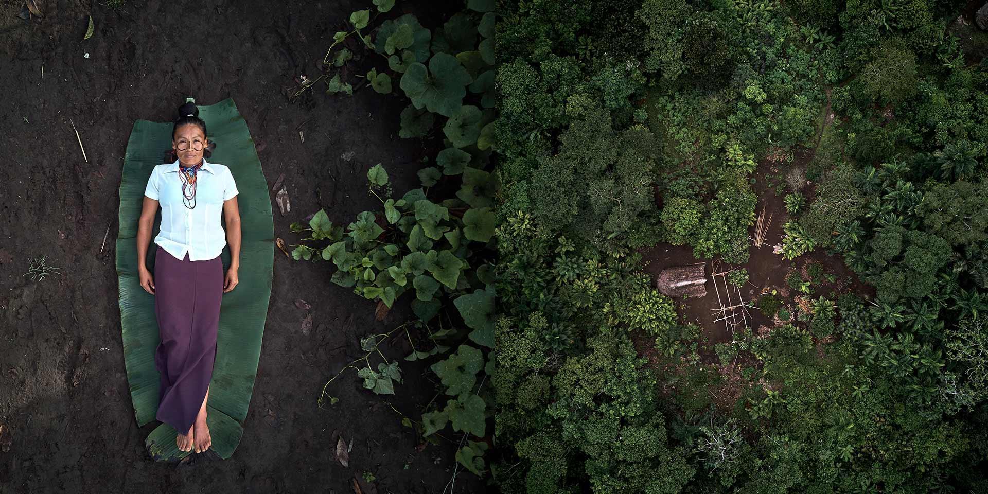 Persona sdraiata a terra accanto alla foresta